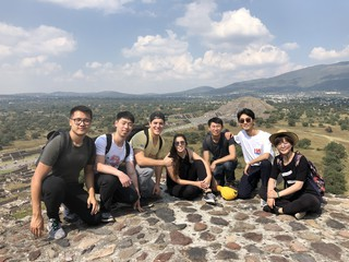 A group of students gathered at the top of Teotihuacan, outside of Mexico City