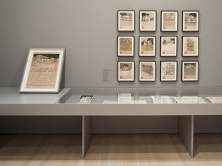 An image of framed documents and artifacts in a gallery