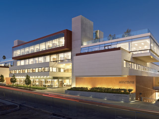 Exterior shot of the Kravis Center at Claremont Colleges, a five-level administrative building with outdoor spaces and a rooftop courtyard.