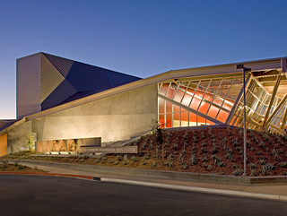 Exterior shot of the Menlo Performing Arts Center, a low profile building with a single folded roof pane.