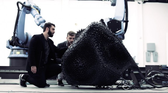 Guvenc Ozel and Benjamin Ennemoser examining Cyper, an robotic sculpture controlled by sensors and virtual reality
