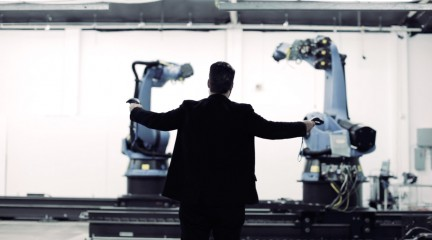 Image of Guvenc Ozel manipulating robots at the IDEAS campus