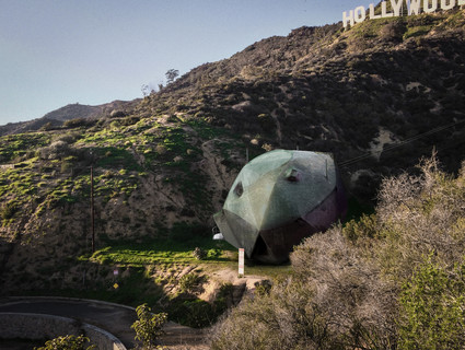 Image of Last House on Mulholland, a space-ship looking house nestled beneath the Hollywood sign.