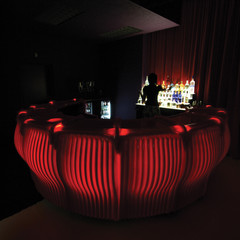 Image of No Good Television Bar, a private bar in a dimly lit room with a heavy, sensual atmosphere of rich red color.