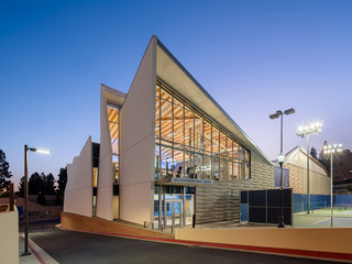 Image of the exterior of the UCLA Basketball Practice Facility, with a roof that is cut into an undulating pattern.