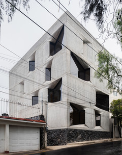 Image of an angular buidling made of concrete and glass