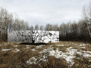 Rendering of a white block-like building in wintery woods