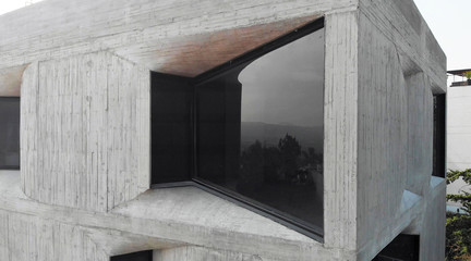 Image of the corner of an angled building window