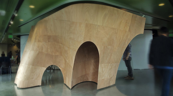 Curved wood installation in a gallery setting