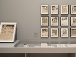 Image of a collection of images in frames on the wall for Frank Lloyd Wright at 150, an exhibition at MOMA in New York