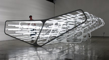 Image of an installation made of articifial light and steel in a gallery space