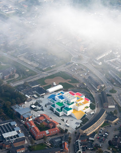 Aerial shot of the Lego Headquarters, a colorful stacked block-like building.