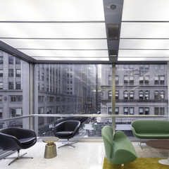 Image of a modernist interior of an office building looking out to a New York cityscape