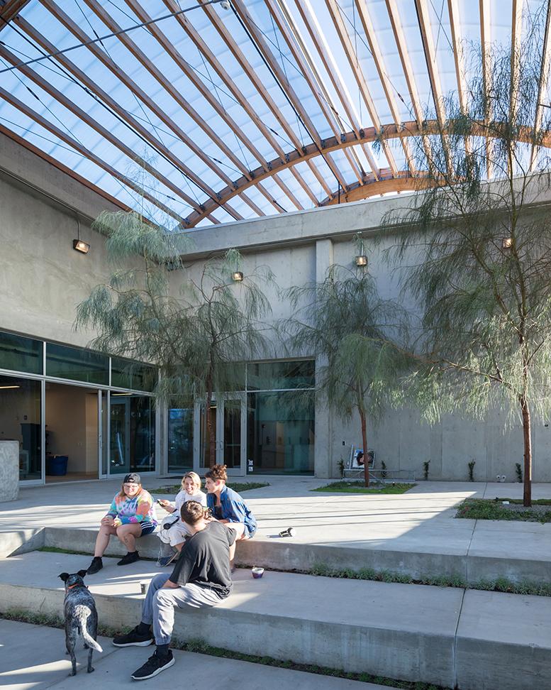 Students sitting in the new UCLA Margo Leavin Graduate Art Studios: