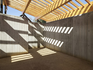 Image of concrete interior with wooden roof