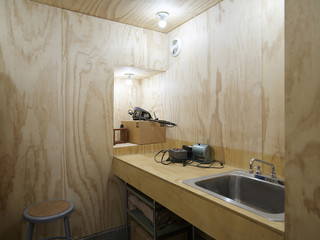Photo of bathroom with wooden walls
