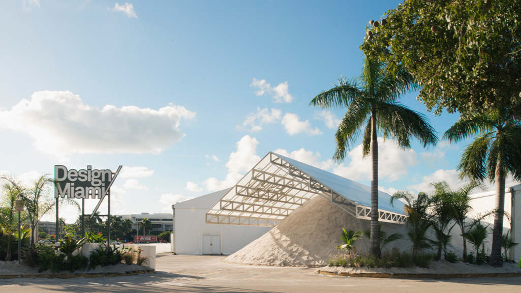 Image of a pile of sand under a white tent covering