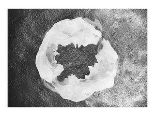 aerial view of a mountain shrouded in clouds