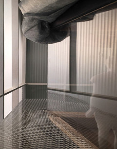 Interior shot of a glass floor with large duct work