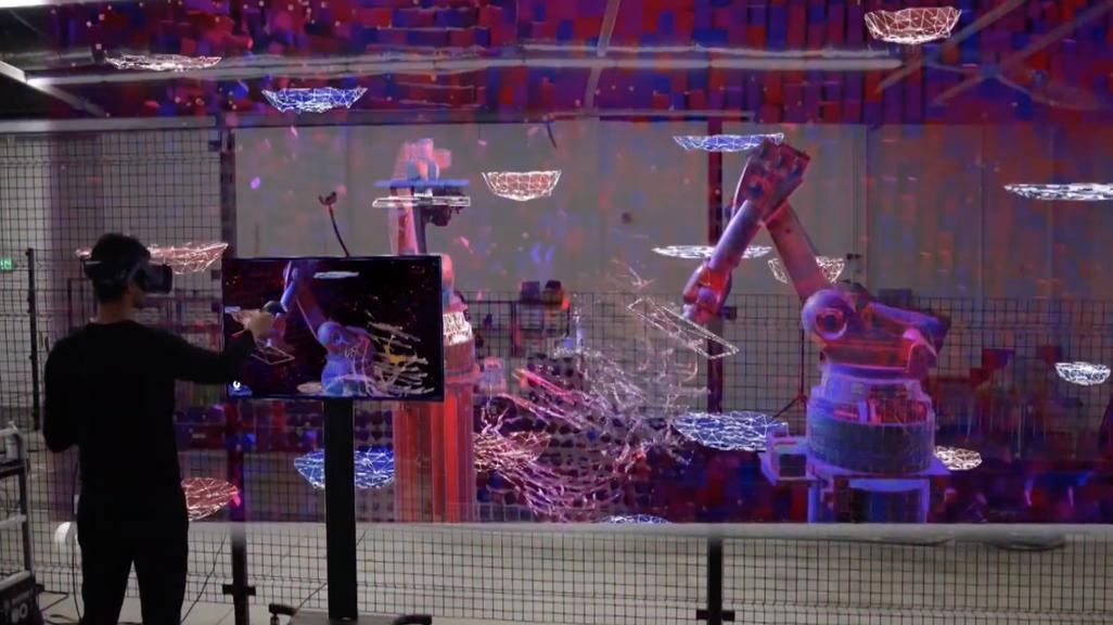 Video still of a student manipulating robotos through VR