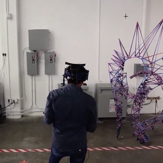 Image of a student with VR headset on projecting a blue and purple spiked avatar