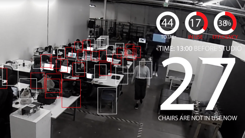 Screenshot from the video showing a robotic red chair navigating a constructed maze using mapping technology.