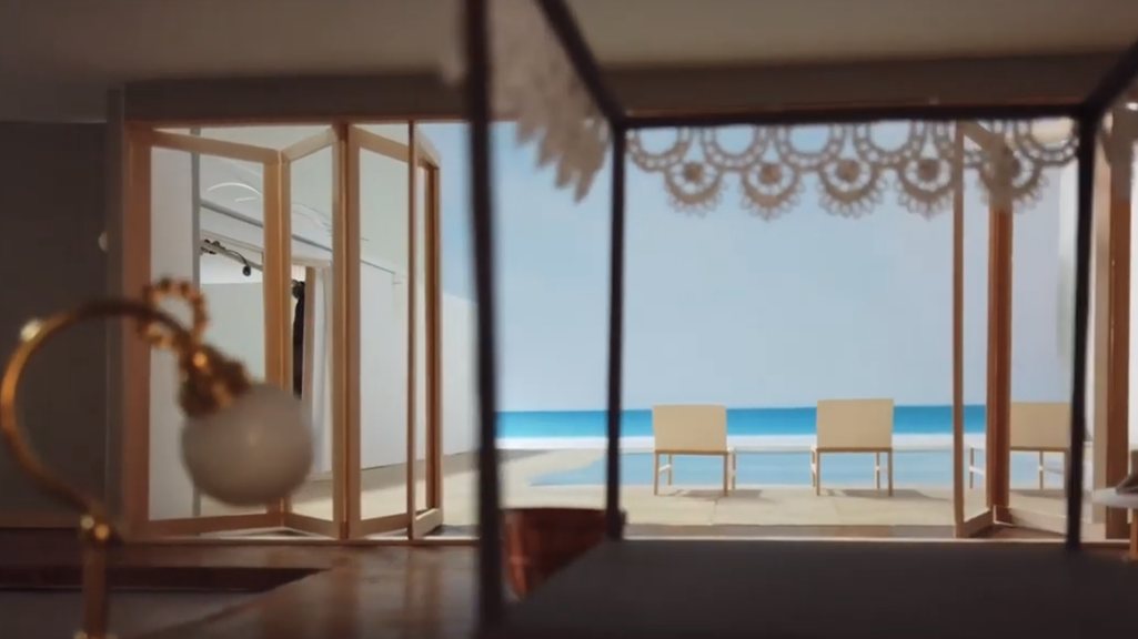 Screenshot from student video showing a view of a model of a house from inside the bedroom looking out onto a pool.