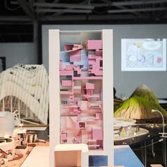 Image of a final student model representing a high-rise structure with a pink interior on the reimagined island of Tuvalu.