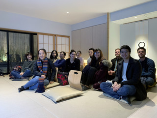Image of students on a trip to Tokyo experiencing traditional reclined seating in a Japanese work environment